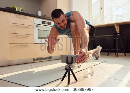 Cheerful Young Man Having Online Workout At Home