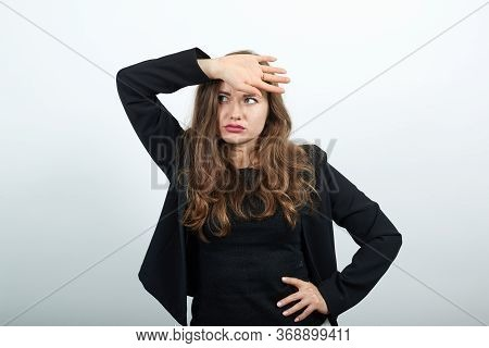 Young Attractive Woman Brunette In In Black T-shirt, Sweater On White Background, A Tired Woman Afte