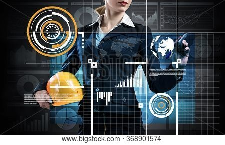Businesswoman Pointing On 3d Financial Graph. Woman In Business Suit Standing With Safety Helmet. Di