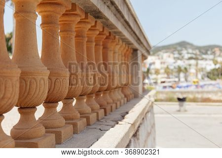 Selective Focus Of Wall With Baluster And Sunlight On Urban Street In Catalonia, Spain