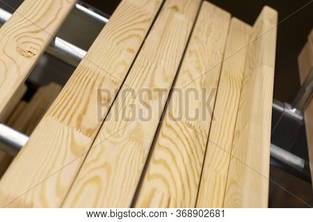 Shelving Of Wood Panels In A Hardware Store. Building Material From Wood, Timber, Boards. Wood Mater