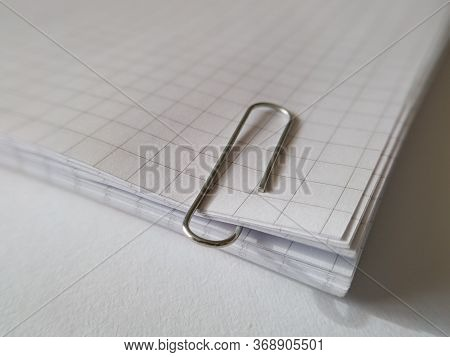 Paper Clip On Hold Sheets Of Notebook. A Paper Clip (or Sometimes Paperclip) Is A Device Used To Hol