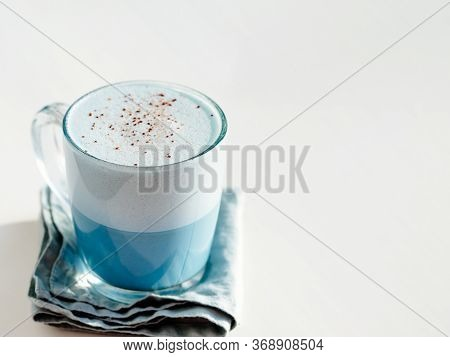 Blue Pea Latte Or Blue Matcha Latte With Copy Space. Hot Fresh Milk With Blue Butterfly Pea Flowers