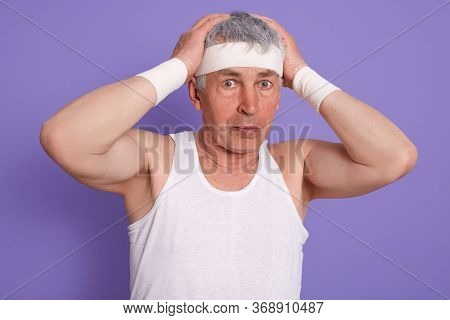Senior Man Scratching His Head In Confusion, Wearing White Sleeveless T Shirt, Touching His Head, Po