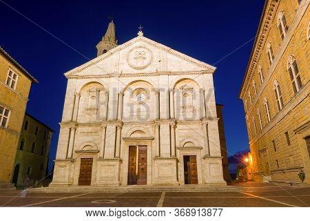 The Medieval Cathedral Of Duomo Di Pienza Santa Maria Assunta In The Late Evening. Pienza, Italy