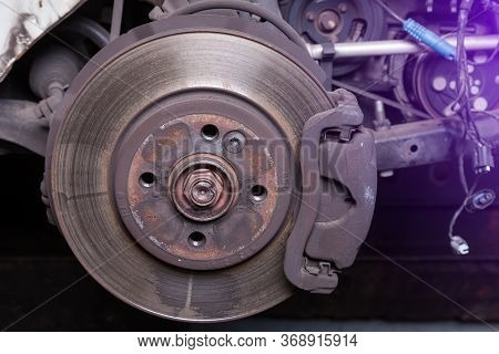 Close-up Metal Disk In Blue Backlight - Main Element Of Brake System. Friction Surface For Brake Pad