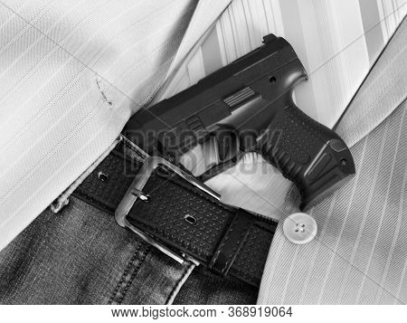 A Gun Tucked Into A Leather Belt So Close, Black And White Image