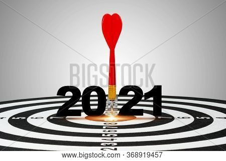 One Red Dart Arrow Hit On 2021 Of  Centre Target Of Dartboard. It Is Symbol For Business Hitting To