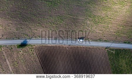 Parallel Lines From An Aerial View Of Farm Land And A Dirt Road. Drone Picture Of Gravel Road That S
