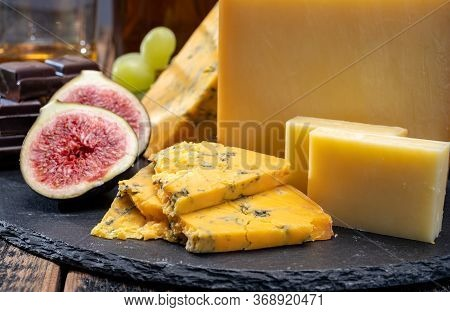 British Matured Yellow Cheese Blue Shropshire, Smoked Cheddar And Fresh Figs Close Up