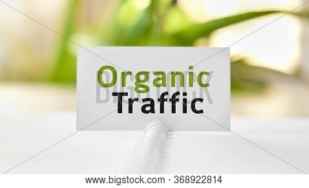Organic Seo Traffic - Business Seo Concept Text On A White Notebook And Green Flowers