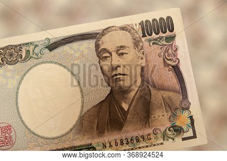 Yen - Japanese Money: Close-up Of 10,000 Yen Banknote. Front View. Isolated On Blurred Background. H