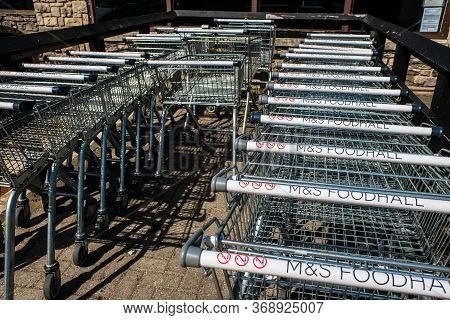 Kendal Uk 28 May 2020 Row Of M And S Foodhall Trollies Outside Shop Ready For Shoppers To Use.