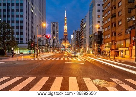 Tokyo Tower at dusk with Tokyo skyline city scape in monato ward. Tokyo Tower is famous landmark height 332.9 metres, the second-tallest tower in Japan.