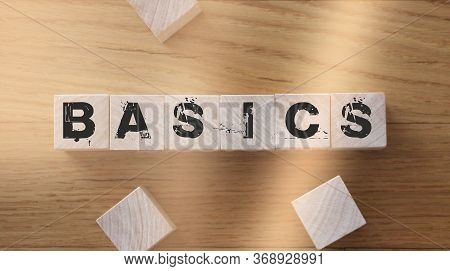 Basic Word On A Wooden Blocks On A Light Background