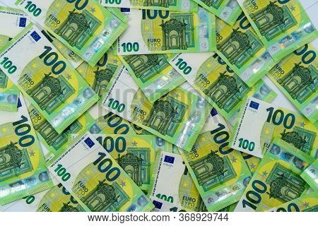 Banknotes Of 100 Hundred Euros Are Scattered In A Chaotic Manner. European Lies On The Table. Blank