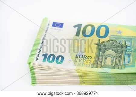 A Pack Of Notes 100 Hundred Euros. European Currency. On White Background. Part Of A Batch Of Money.
