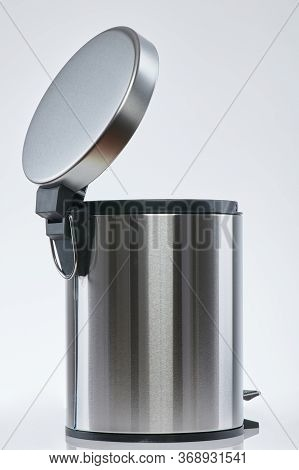 Aluminum Shiny Rubbish Bin With Open Lit Isolated Back View