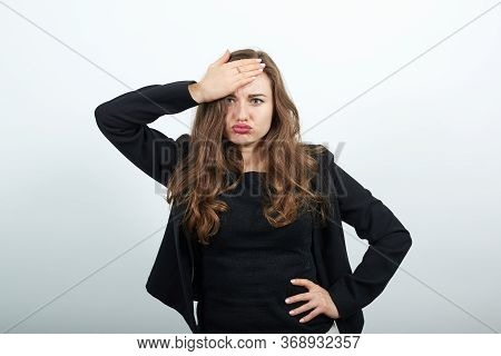 Young Attractive Woman Brunette In In A Black T-shirt And Sweater On White Background, Angry, Irrita
