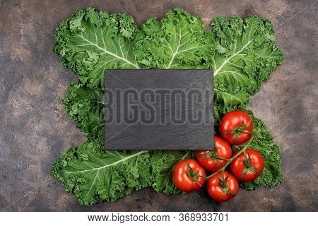 Kale Salad Leaf And Red Tomatoes With Water Drops