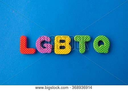 Colored Letters With Word Lgbtq On Blue Background