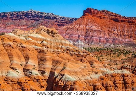 USA. Arizona, Utah. Huge slopes of red sandstone, striped from various inclusions of light rocks. Paria Canyon-Vermilion Cliffs Wilderness Area. The concept of active, extreme and photo tourism