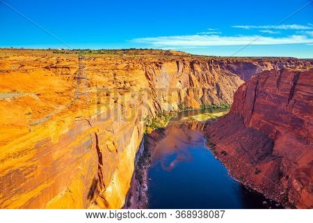 Colorado River Curves in canyon steep turns. Best journey in life. Glen Canyon Dam across the Colorado River. Concept of active, ecological and photo toursm