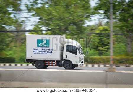 Samut Sakhon, Thailand - May, 2020: Small White Trucks Running On Phuttasakhon Road On May 10, 2020