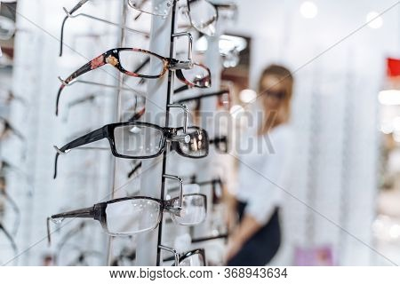 Showcase With Spectacles In Modern Ophthalmic Store. Eyeglasses Shop. Stand With Glasses In The Stor