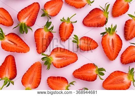 Strawberry Slices On A White Background Flat Lay. Food Background.