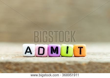 Colorful Bead With Black Letter In Word Admit On Wood Background
