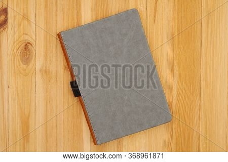 Gray Hardcover Book On Pine Wood Desk With Copy Space For Your School Or Reading Message Or Mockup