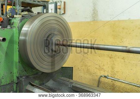 Metal Fiber Is Rotating Around Big Drill Of Steel Metal Lathe Machine Engine, Technology Manufacture