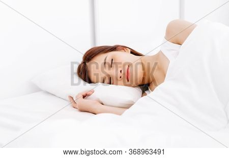 Portrait Of Relaxed Beautiful Asian Woman Sleeping On White Bed In The Bedroom In The Morning. Lady