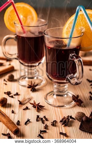 Differential Focus. Limpid Glasses With Hot Mulled Wine, Cloves, Fragrant Cinnamon Sticks, Anise Flo