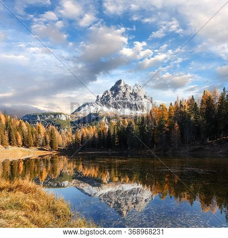 Beautiful Landscape Of Alpine Lake Under Bright Sunlight. Incredible Nature Landscape Of Dolomites A
