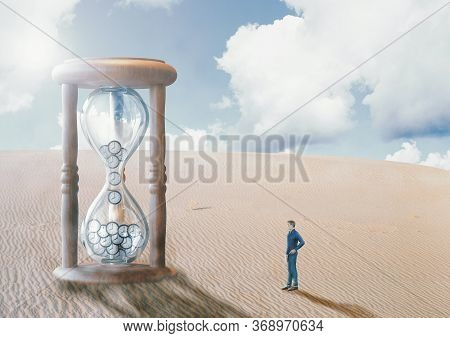Man Before Hourglass, In The Desert, Watching Time Run Out. End Of Time Concept, Doomsday And Fulfil