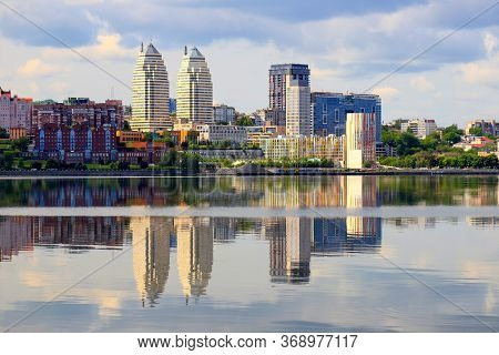 Summer River View Of A Big City. Clouds Over The Dnieper, Skyscrapers And Towers Are Reflected In Th