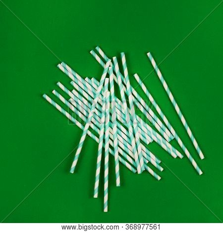 Top View Of Colorful Paper Disposable Eco-friendly Straws. Drinking Straw With Green Stripes For A P