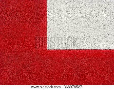 Two-tone Red-white Wall With A Slightly Rough Texture, Divided Into Two Unequal Parts