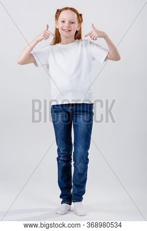Girl In White T-shirt. T-shirt With Copy Space. Young Caucasian, European Woman, Girl In White T-shi