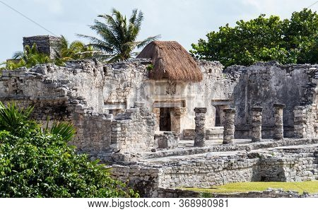 Ancient Ruins In The Warm Tropical Sunlight. Situated In The Mayan City Of Tulum In Quintana Roo, Me