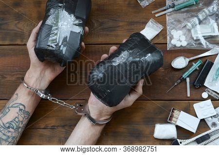 Drug Trafficker Arrested With Their Heroin Packages. Police Arrest Drug Dealer With Handcuffs And Ma