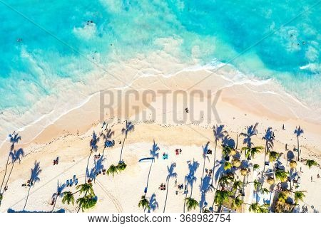Aerial Drone View Of Beautiful Atlantic Tropical Beach With Palms And Straw Umbrellas. Bavaro, Punta