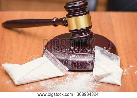 Law And Order Against Drugs. Court For The Illegal Use Of Drugs. Judges Gavel And White Powder In Th