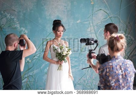 Saint-Petersburg / Russian Federation - 16 July 2019: Photoshoot of bride by group of professional photographers at wedding