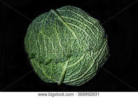 Savoy Cabbage On A Dark Background Close-up. Leaf, Agriculture.