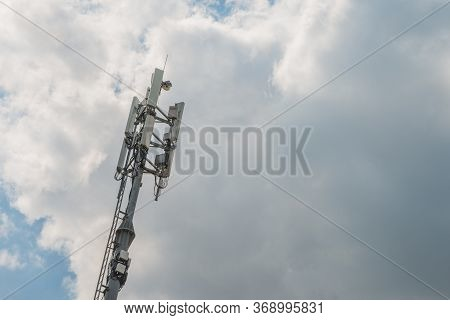 3g, 4g, 5g Fast Speed Wireless Internet Connection Communication Station On The Cloudy Dramatic Sky.