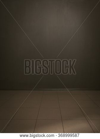 Dark Gray Painted Wall And Tile Floor Background. Template For Ideas And Creativity. Copy Space Or T