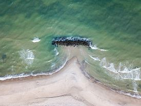 Liseleje, Denmark - April 4, 2020: Aerial Drone View Of A Breakwater At Liseleje Beach.